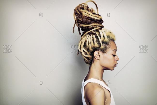 Black woman with dreadlocks bun