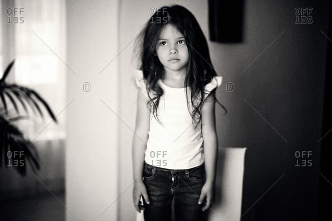 Caucasian girl standing on chair