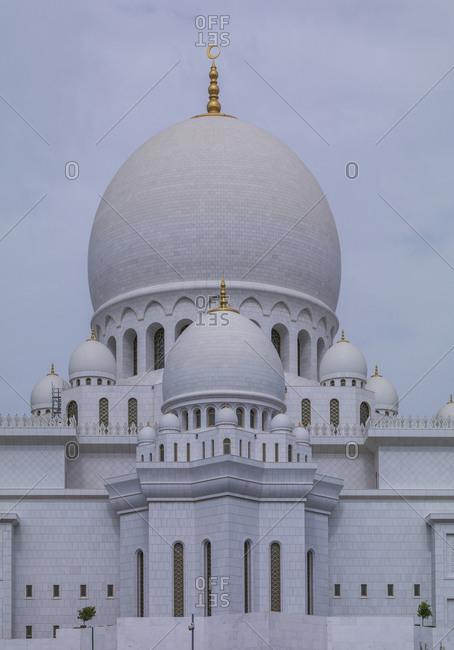 Ornate domed building under cloudy sky, Abu Dhabi, Abu Dhabi Emirate, United Arab Emirates
