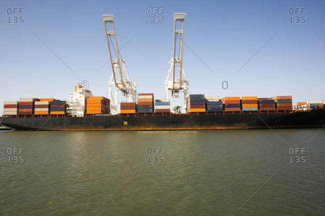 Cranes and shipping containers on barge