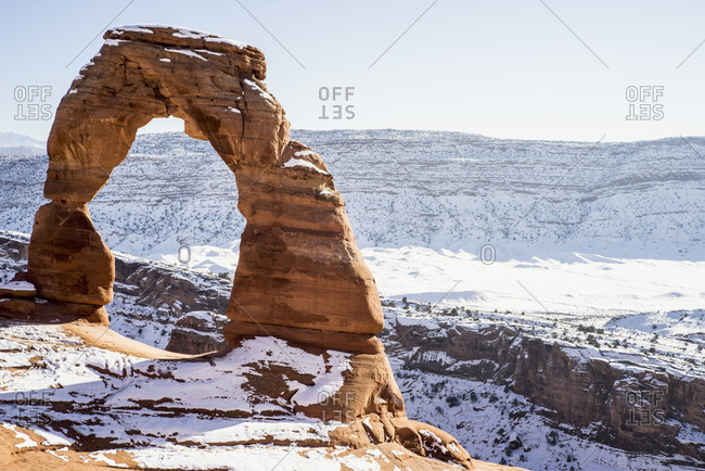 Rock formation in snowy desert park, Moab, Utah, United States