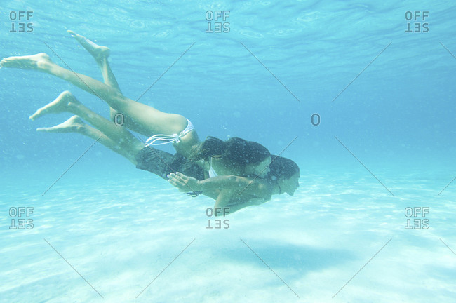 Underwater view of couple swimming in ocean