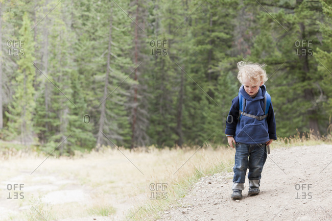 Caucasian boy hiking in forest