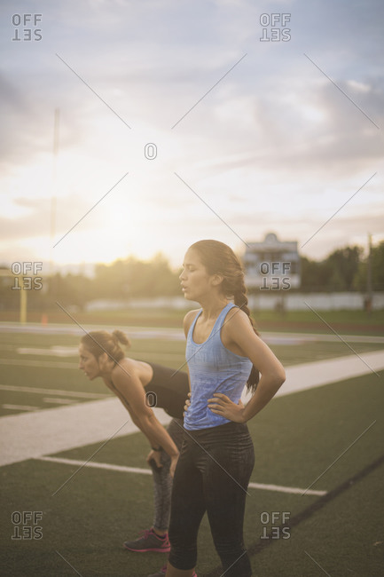 Athletes resting on sports field