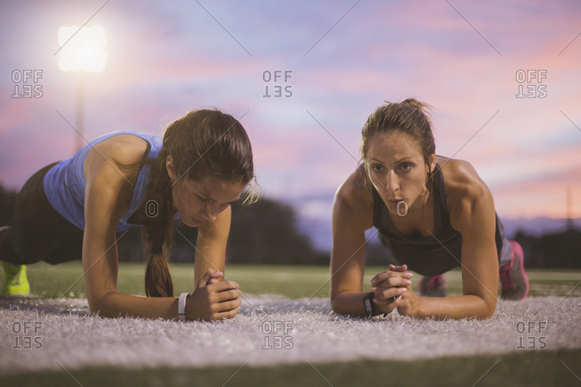 Athletes working out on sports field