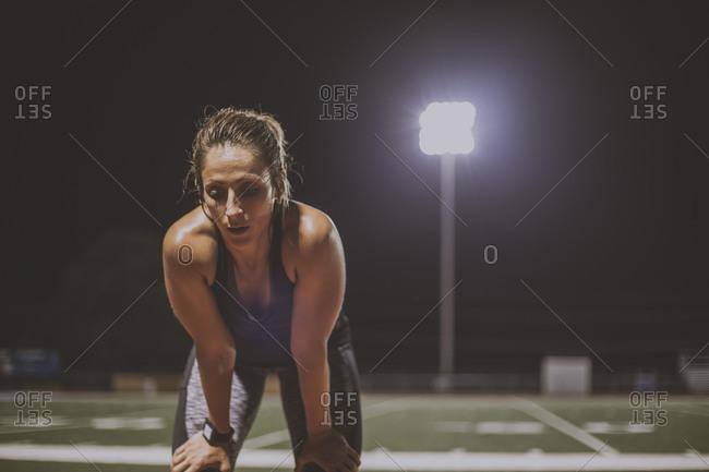 Caucasian athlete resting on sports field