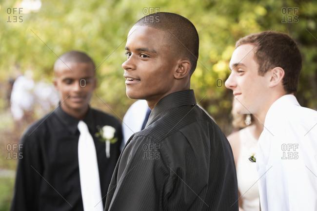 Teenage boys talking before prom