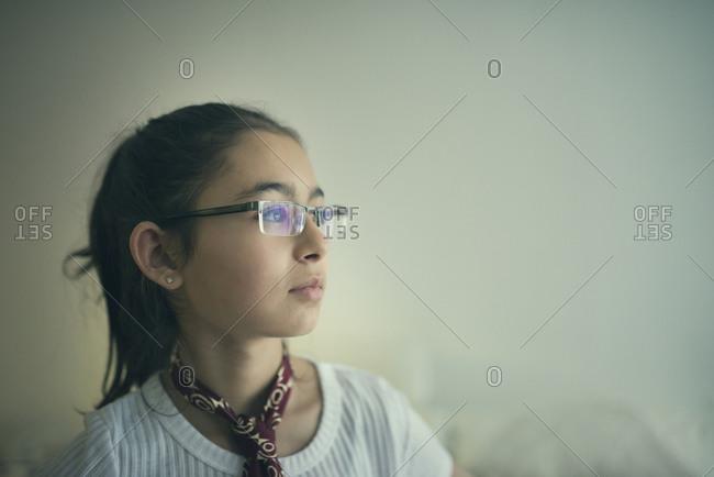 Mixed race girl in eyeglasses looking sideways