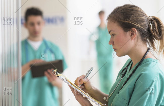Doctor writing notes in hospital emergency room