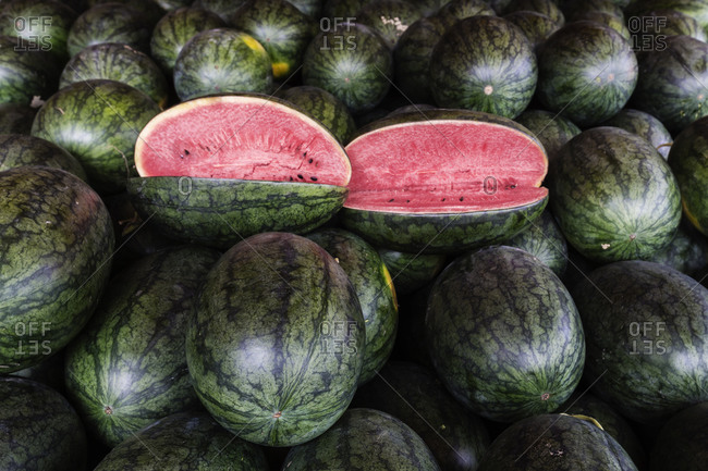 Sliced watermelons for sale in market