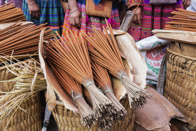 Baskets of reed brooms for sale in market