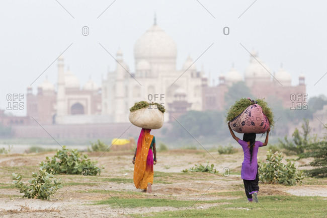 Rear view of women carrying baskets on their heads
