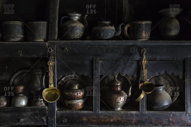 Traditional utensils in shelves