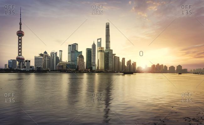 Shanghai city skyline reflecting in waterfront, Shanghai, China