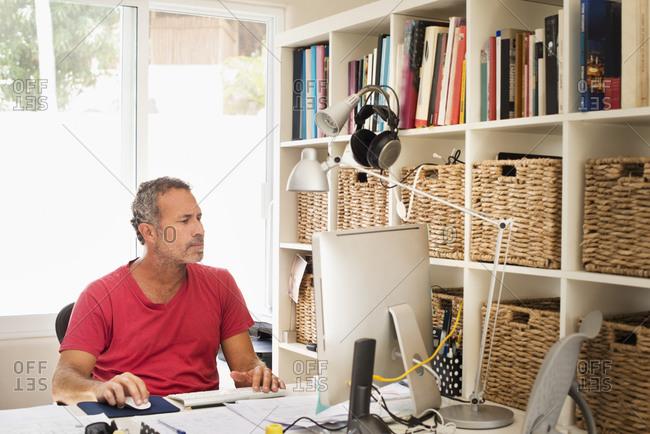 Hispanic man working in home office