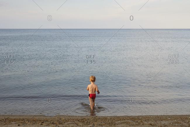 Caucasian boy playing on beach