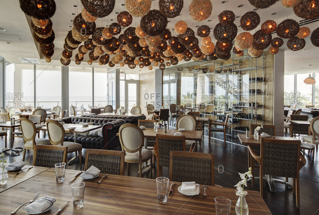 Lanterns over tables in modern restaurant