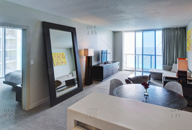 Mirror and lounge area in hotel room