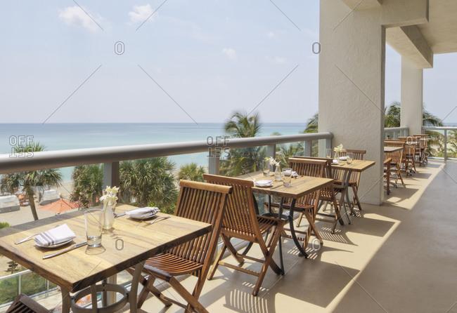 Empty tables on restaurant balcony