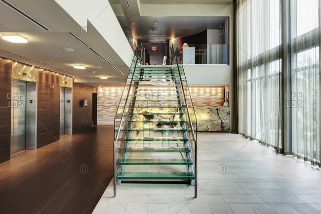 Glass staircase in hotel lobby