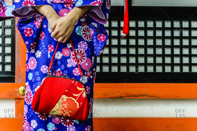 Close up of woman in kimono holding purse