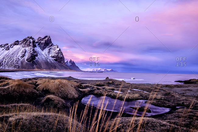 Mountains over beach and remote fields