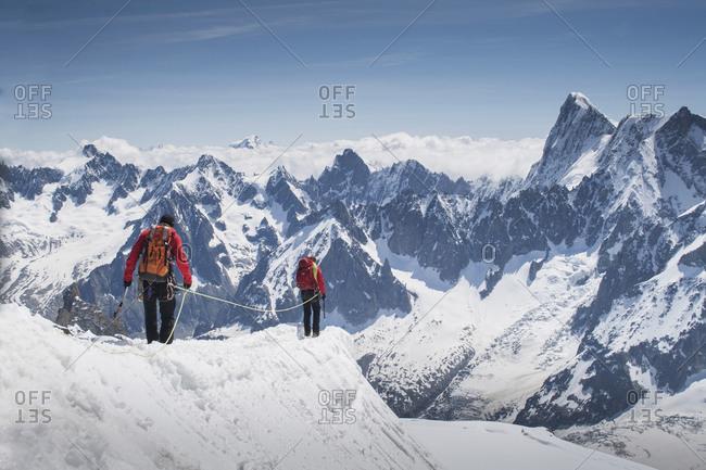 Caucasian skiers walking on mountaintop, Mont Blanc, Chamonix, France