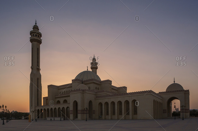 Mosque and tower under sunset sky, Manama, Bahrain