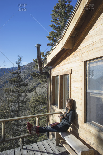 Caucasian woman admiring view from cabin deck