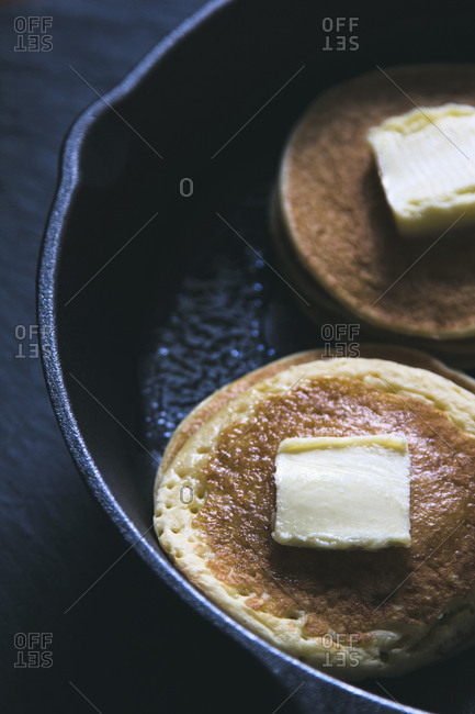 Close up of butter on pancakes in pan