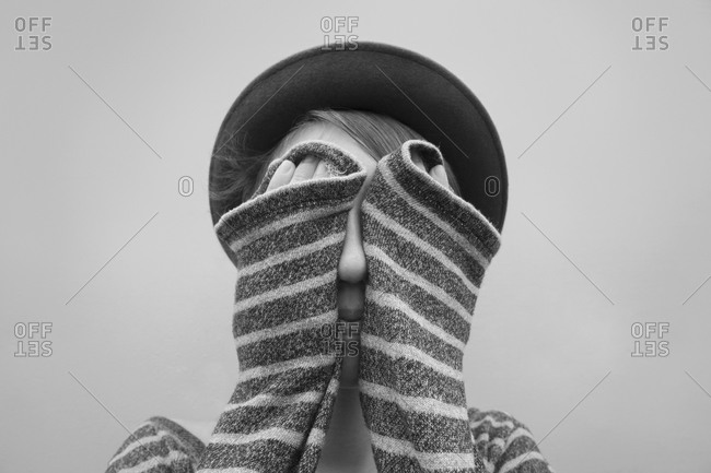 Caucasian girl covering her face