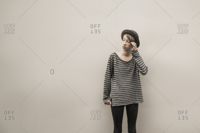 Caucasian girl standing at wall
