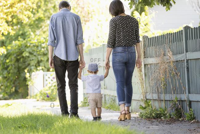 Family walking in neighborhood