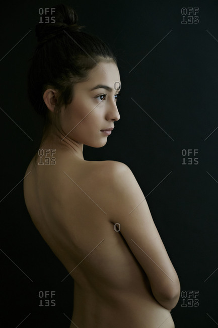Nude Hispanic woman looking away