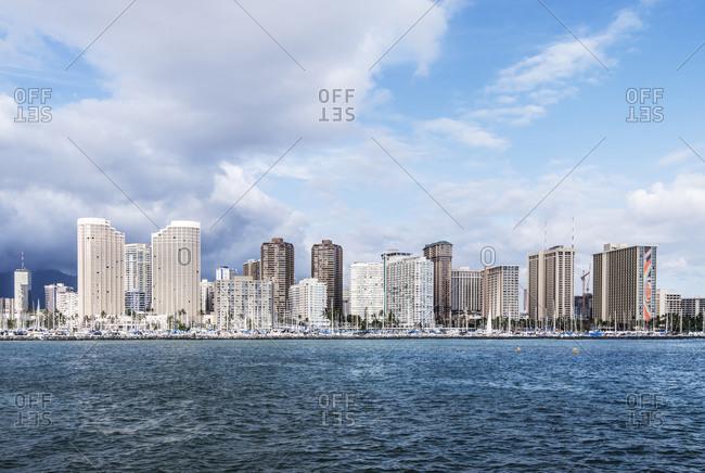 Honolulu city skyline over ocean, Hawaii, United States