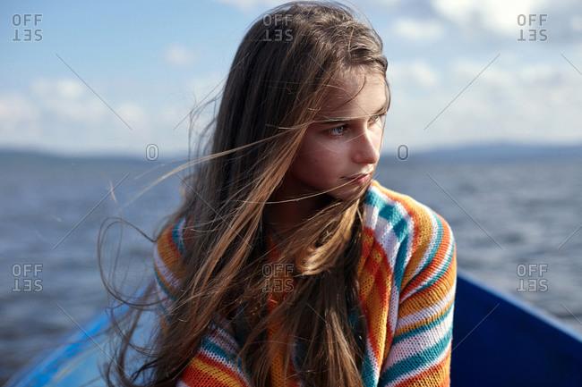 Caucasian teenage girl in canoe on lake