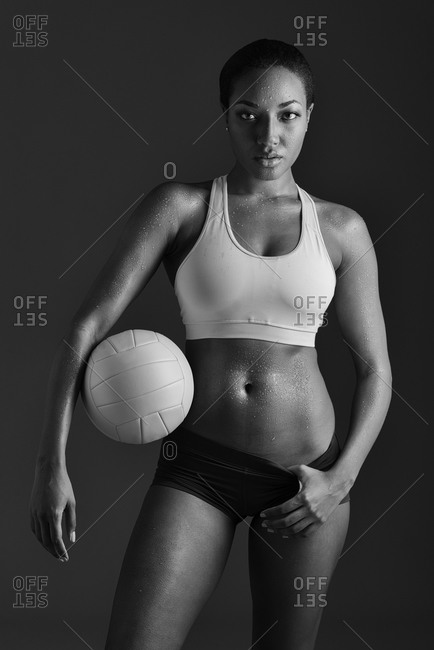 African American woman holding volleyball