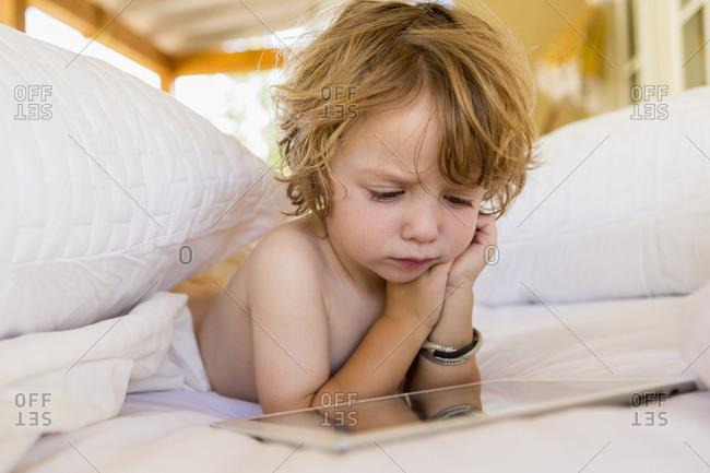 Caucasian boy using digital tablet