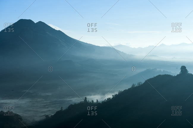 Mountains and morning fog in remote landscape, Kintamani, Bali, Indonesia
