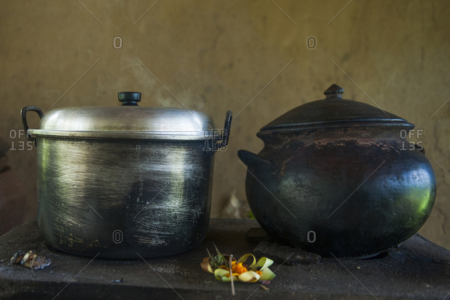 Close up of iron and steel pots on kitchen counter