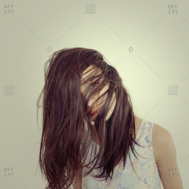 Mixed race girl tossing her hair