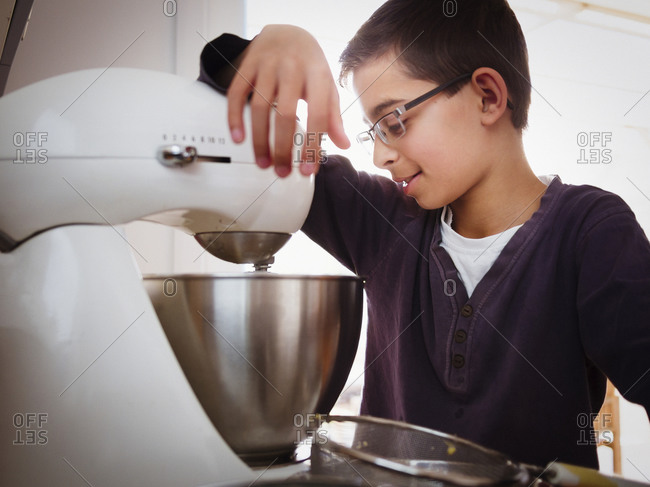 Mixed race boy baking in kitchen