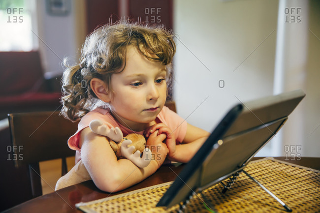 Caucasian girl watching digital tablet