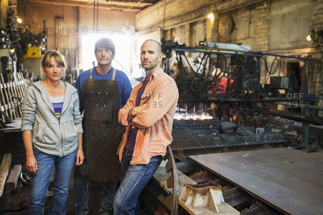 Caucasian workers standing in factory