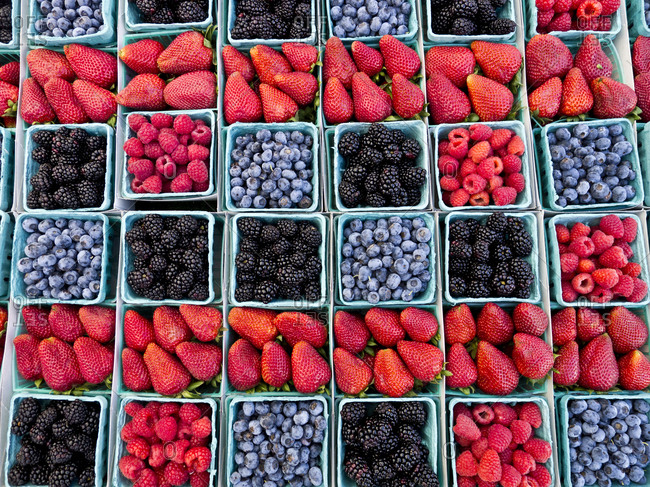 Pints of fruit for sale in farmers market