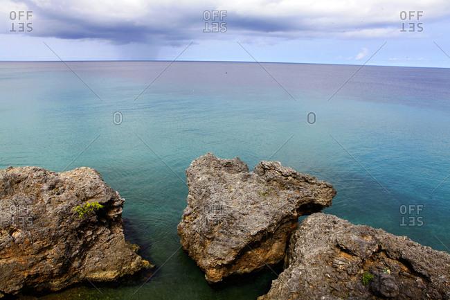 Rock formations in still ocean water