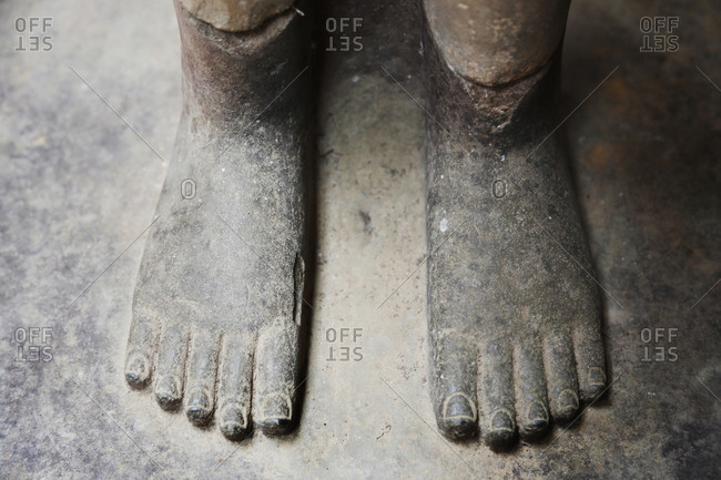 Close up of statue feet