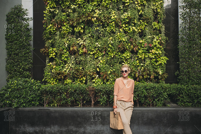 Caucasian woman carrying purse outdoors