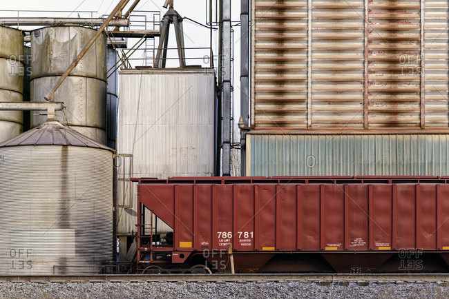 Container on train tracks in industrial train yard