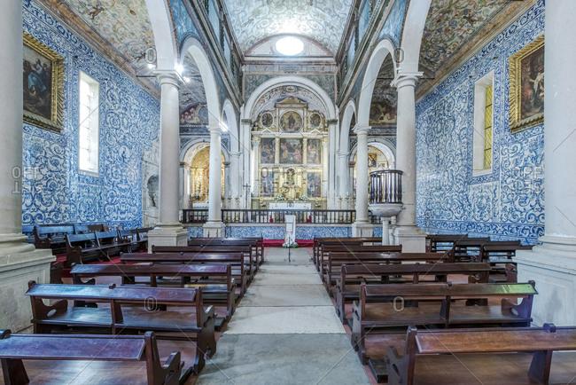 Ornate arches and pews in Iglesia de Santa Maria, Obidos, Leiria, Portugal